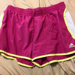 Pink and yellow Adidas running shorts
